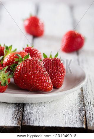 Fresh Ripe Red Strawberries In White Plate On White Wooden Rustic Background