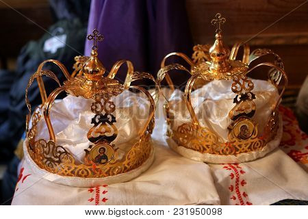 Gold Crowns For A Wedding In Church. Icon Crosses