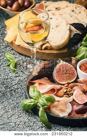 Italian Antipasti Wine Snacks Set. Cheese Variety, Nuts, Mediterranean Olives, Sauces, Prosciutto Di