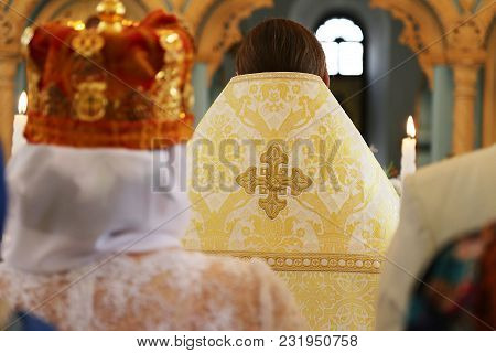 Gold Crowns For A Wedding In Church. Icon Crosses Bible