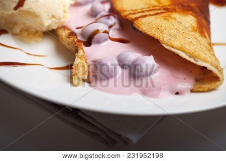 Omelet With Cherry Sauce And Vanilla Ice