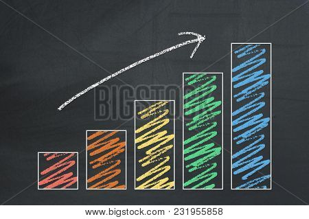 Growing Hand Drawn Business Chart On A Blackboard