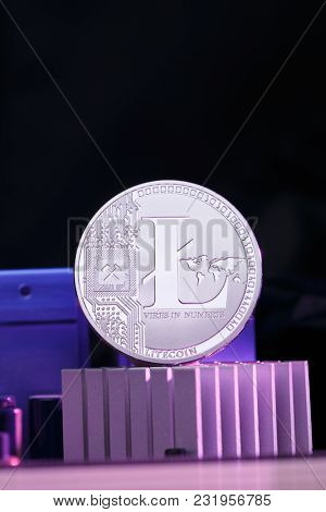 Photo of litecoin and processor on pink background