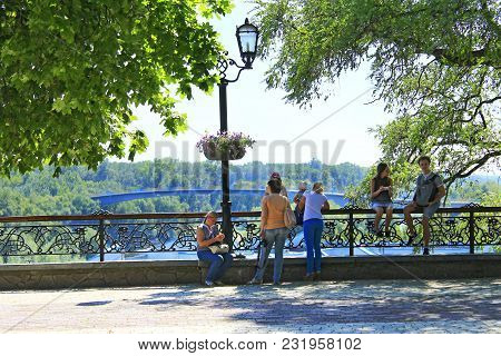 Chernihiv / Ukraine. 28 August 2016: People Having A Rest In The City Park With Big Trees. Summer Ho