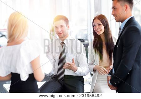 Business team discussing business issues in office workplace