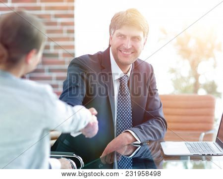 handshake of business people at the desk