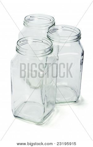 Three Empty Glass Containers