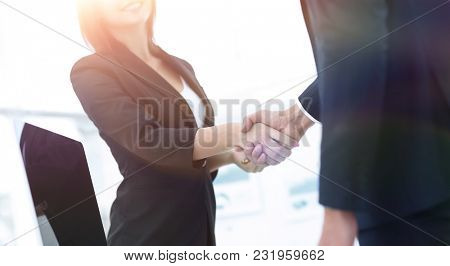 business colleagues shaking hands after a successful presentatio