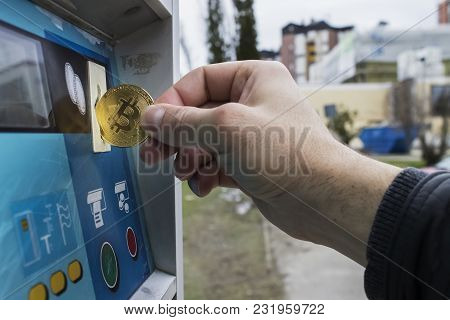 Man Inserting Golden Bitcoin To Parking Machine To Buy Parking Ticket|parking Slot|button