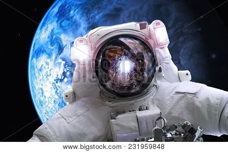 Asrtonaut In Deep Space Near Earthlike Planet . Elements Of This Image Furnished By Nasa