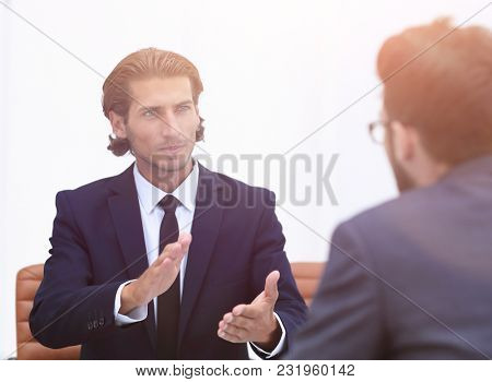 business partners discussing issues sitting