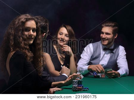 closeup.poker players sitting at a casino table