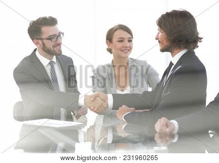handshake of business partners.business background