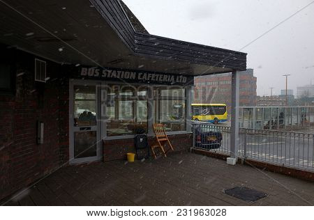 Bracknell, England - March 17, 2018: People Waiting Inside The Bus Station Cafeteria And The Bus Sta
