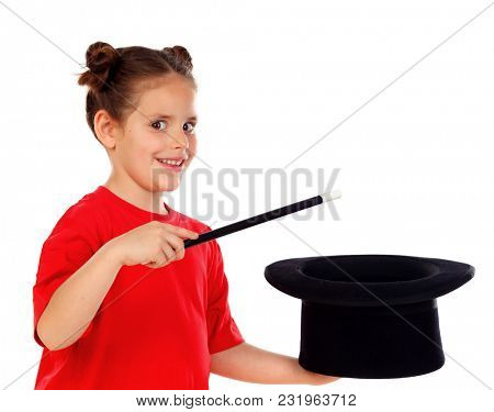 Pretty little girl doing magic with a top hat and a magic wand isolated on a white background