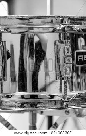 Photographers Self Portrait Reflecting From Side Of A Snare Drum.