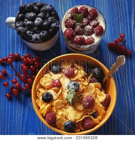 Healthy breakfast. Corn flakes with raspberries and blueberries