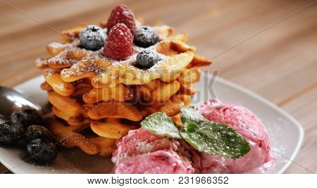 Belgian waffles with fresh berries and ice cream