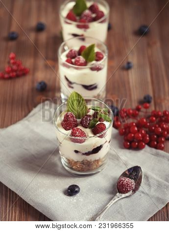 healthy eating and diet concept: Healthy breakfast with yogurt and granola
