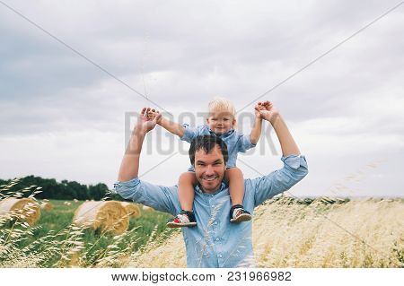 Happy Father And Son. Family Concept. Man And His Little Cute Kid Boy Having Fun On Wheat Field With