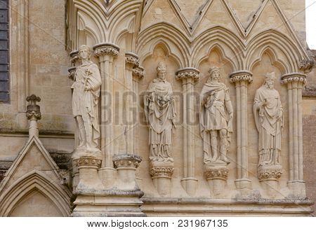 Stone statues at Salisbury Cathedral facade (Cathedral Church of the Blessed Virgin Mary), one of the leading examples of Early English architecture in Wiltshire, South West England, UK
