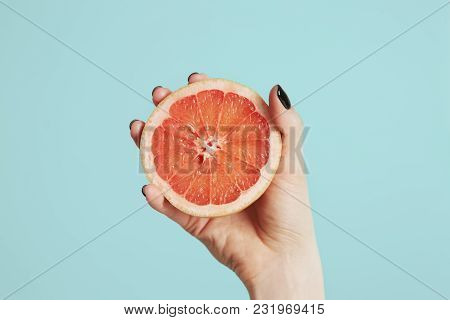 Vitamin C Brown Ampule For Injection With Fresh Juicy Orange Fruit Slides On White Table. High Dose