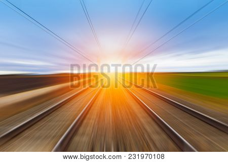 Railroad In Motion At Sunset.