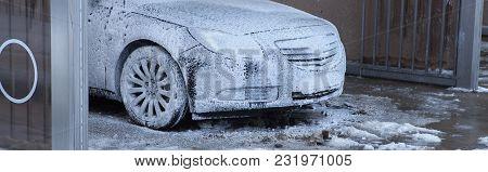 Car Washing Concept. Car In Foam. Auto Sink
