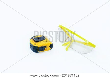 Measuring Tape And Safety Glasses Protection On White Background