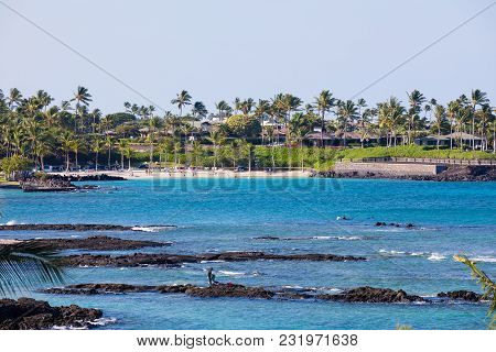 Mauna Lani Bay, Hawaii - January 5, 2018: People Swimming Among The Lava Rock Reef At Mauna Lani Bay