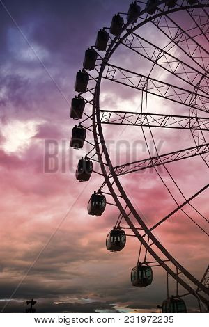 Close-up Of The Giant Ferris Wheel With Sunset Background