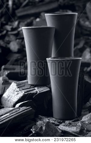 Three Matte Black Shot Glass .on Charcoal Background. Black Edition.creative.let's Drink.cheers.mock