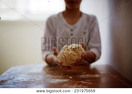Hands Holding Dough Ready For Baking, Closeup