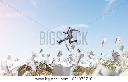 Businessman In Suit Running In The Air Among Flying Papers As Symbol Of Active Life Position. Skysca