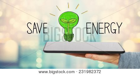 Save Energy With Man Holding A Tablet Computer