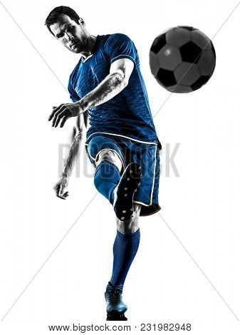 one caucasian soccer player man playing kicking in silhouette isolated on white background