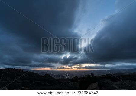 Stormy winter sky after sunset above suburban Simi Valley near Los Angeles California.