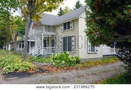 Bay View, Michigan / United States - October 16, 2017:  A Yellow Two Story Victorian Cottage, With A
