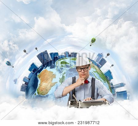 Thoughtful Man Writer In Hat And Eyeglasses Looking Away And Touching Chin While Using Typing Machin