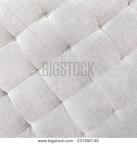 Gray Buttoned Fabric Background. Detail Of A Textile Ottoman. Classic Style Furniture.