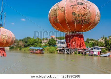 Bright Red Chinese Lantern With Chaopraya River On The Background. Thailand