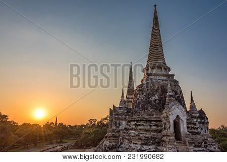 Sunset Over Wat Phra Si Sanphet Temple Ruins. Famous Landmark And Tourist Attraction In Ayutthaya, T