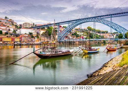Porto, Portugal town view on the Douro River in the early evening.
