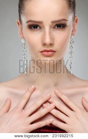 A photo of sexual beautiful girl in a wedding-dress is in fashion style. Wedding decorations
