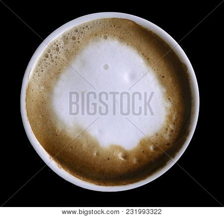 Coffee Cappuccino In A White Cup  Isolated On The Black  Background With Clipping Path. Top View.  C