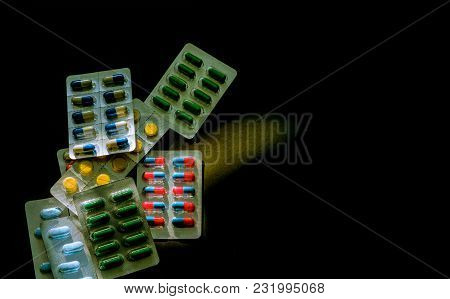 Colorful Of Antibiotic Capsule Pills In Blister Pack On Dark Background With Copy Space. Medicine Fo