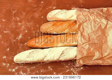 Fresh Baked Bread On Wooden Table Background
