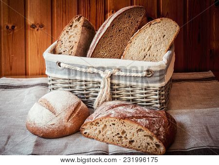 Wicker Basket With Fresh Bread On Table