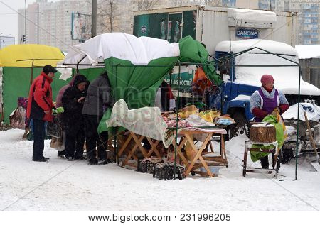 Meat market in the city at winter. Heavy snowfall.Kiev,Ukraine.March 17, 2018