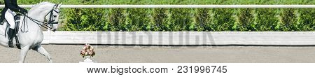 Dressage Horse And Rider In Uniform During Dressage Competition. Horizontal Photo Banner For Equestr